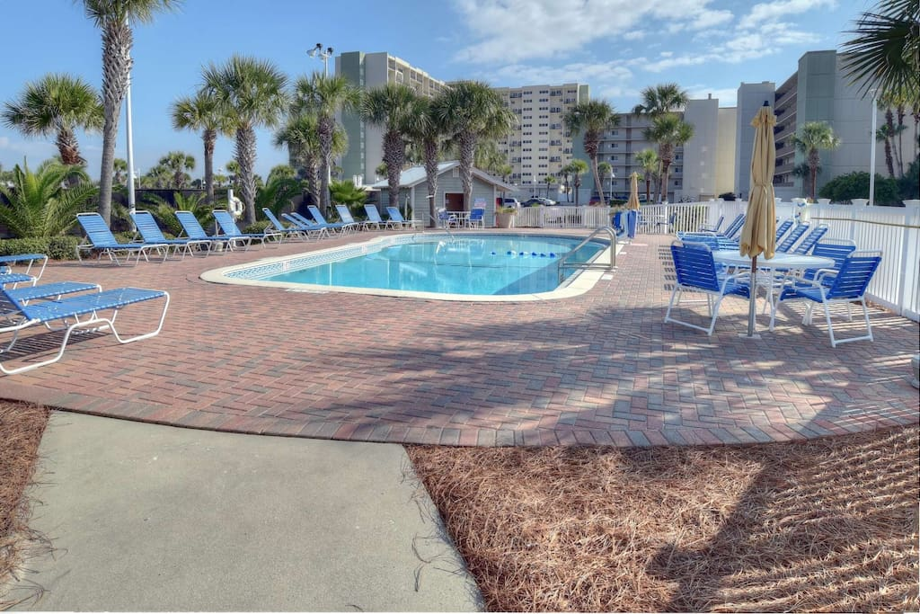 Resort Outdoor Pool for Sunbathing and Relaxing - Plenty of Lounge Chairs and Tables for your Enjoyment!
