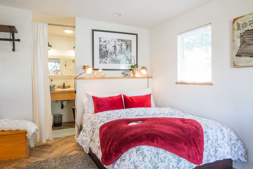 240-square foot standalone cottage with full-size bed, kitchenette, and separate bathroom area