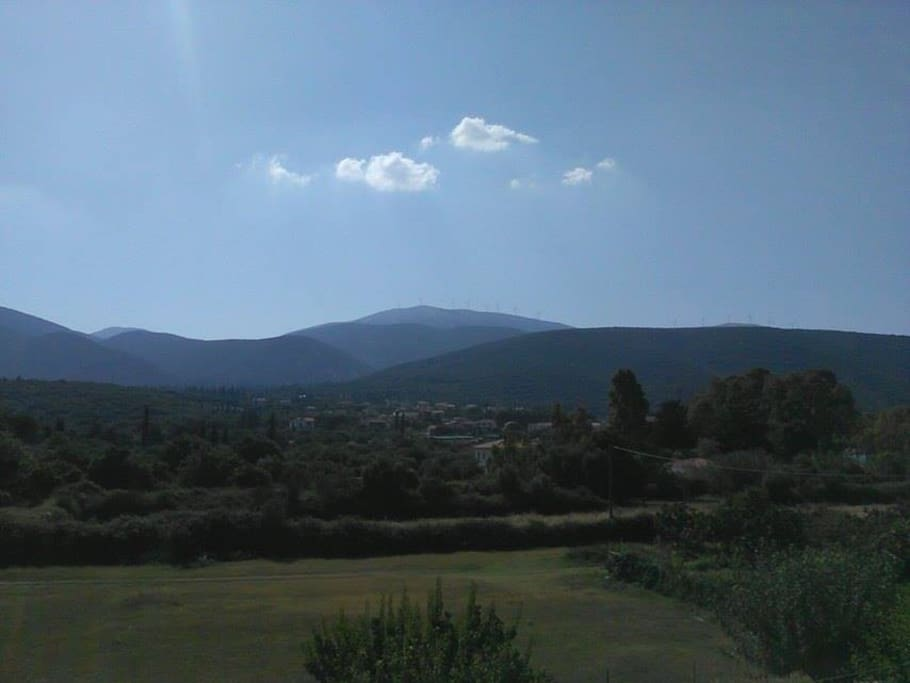This bedrooms' balcony view...The neighboring graphical village of Karavomilos with its surrounding mountains.