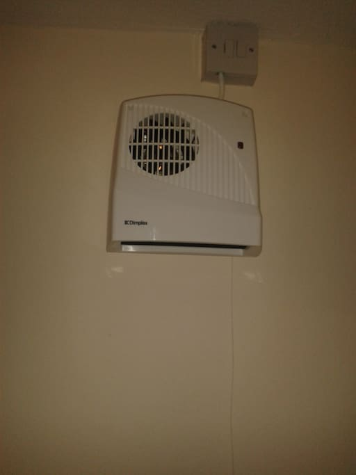 Another Heater above Towel Rail in Bathroom