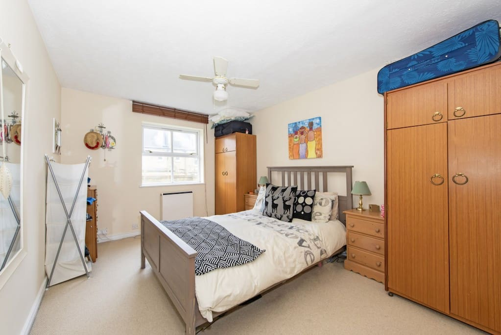 Bedroom with double bed and ample storage