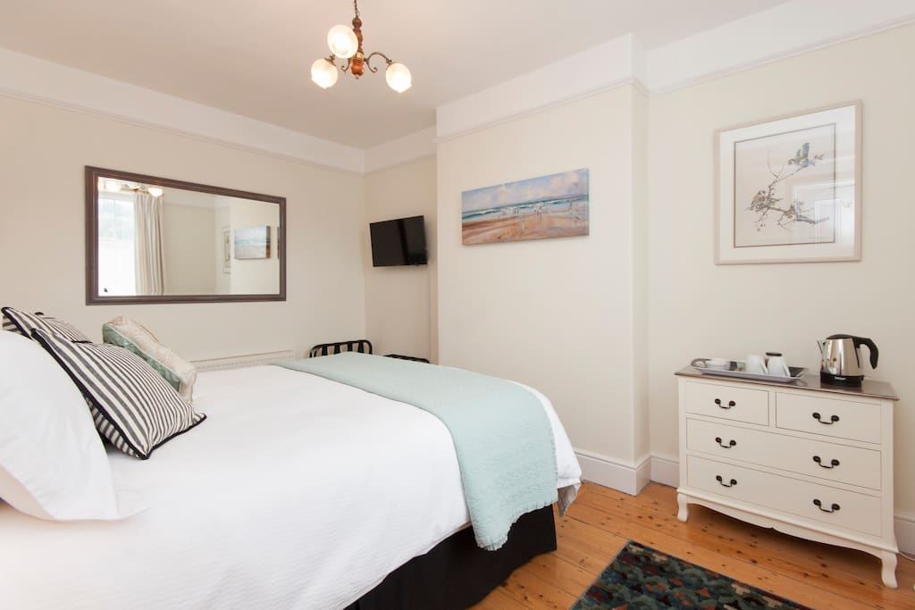 Enjoy your spacious comfortable bedroom.