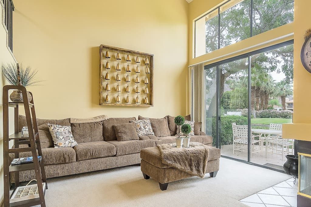 Take in golf course views from the bright living room