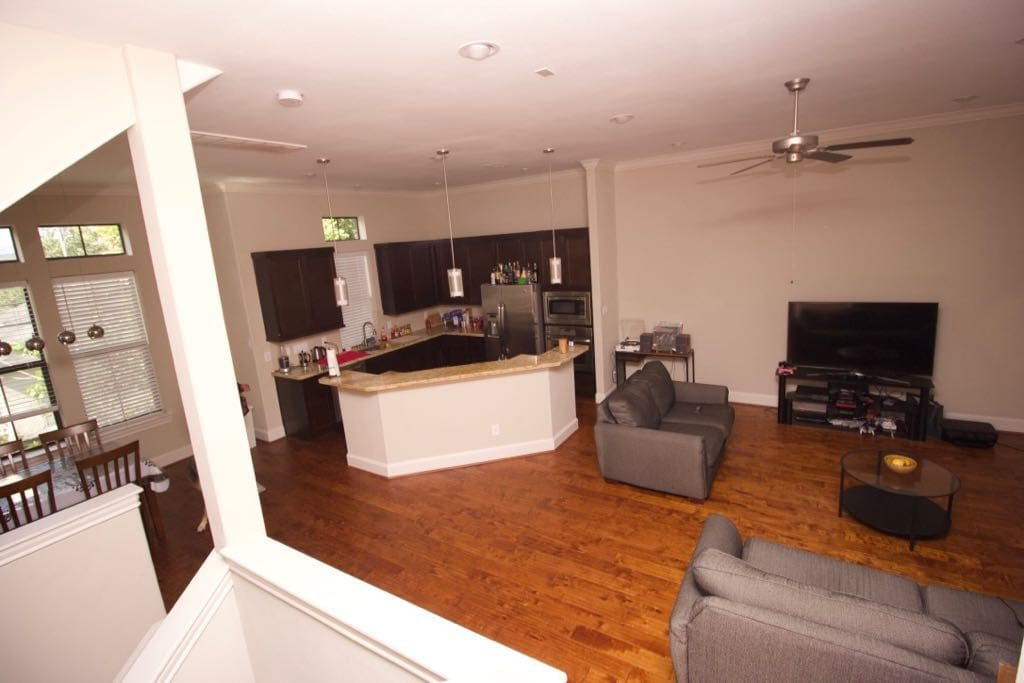 Upstairs living area has a full kitchen, breakfast space, guest bathroom and a balcony.