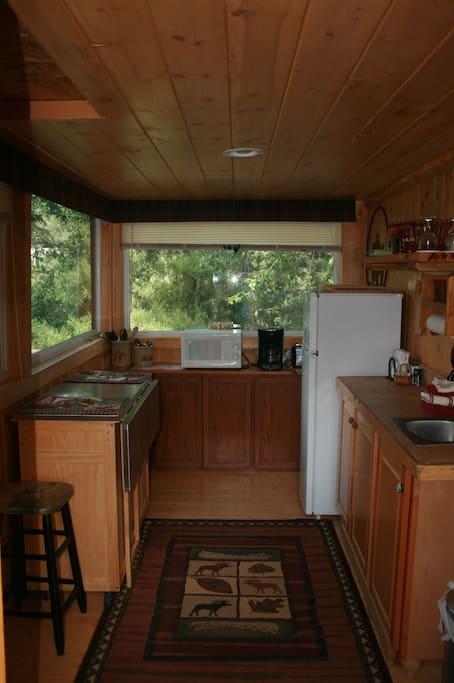 Bunkhouse kitchen refrigerator, microwave, hot plate, toaster, coffee maker, blender