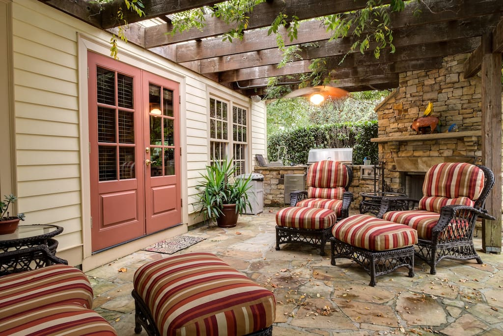 Comfortable outdoor seating with lighted ceiling fans, gas grill and outdoor fireplace.