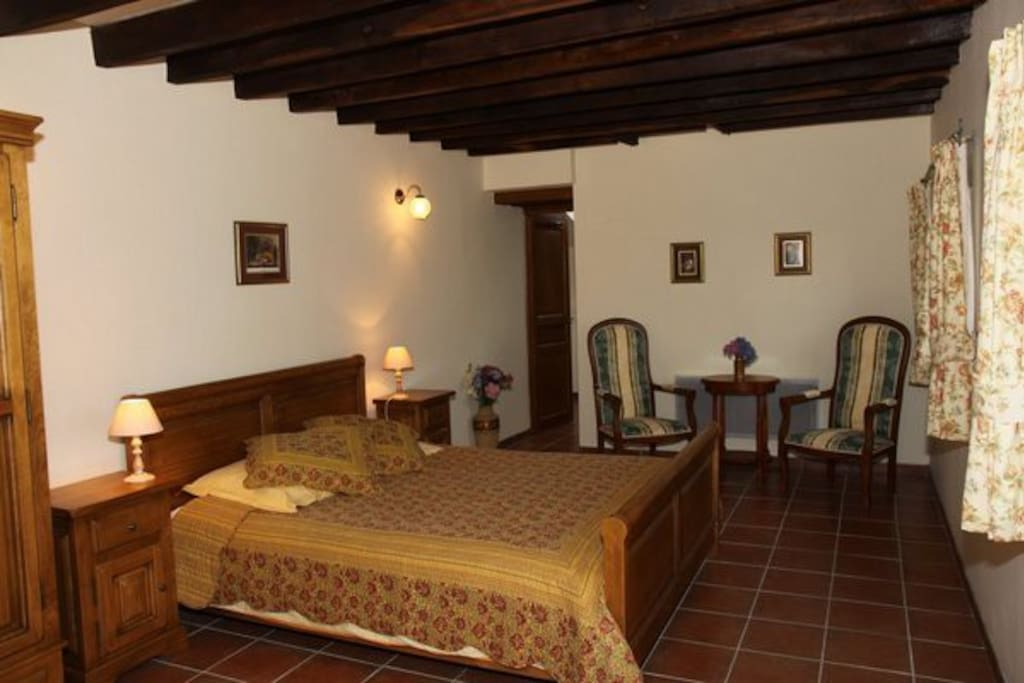 Beautiful en-suite room with king bed and rural views.