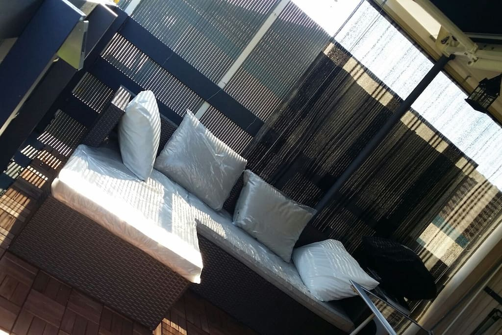 The private bacony for morning and afternoon relaxation with retractable shutter/roof top to adjust the light level.