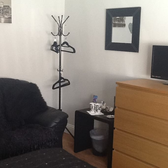 Sofa,hanging space,hospitality tray with tea,coffee,hot chocolate and biscuits