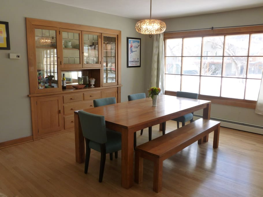 The teak dining room table comfortably seats 8, but you can squeeze in more!
