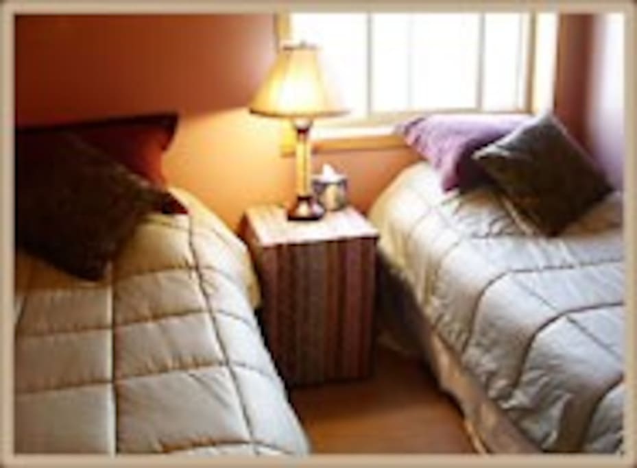 Two single beds in the second bedroom .