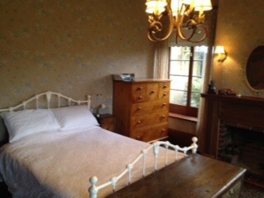 Master Queen bedroom with Huon Pine chest & fireplace