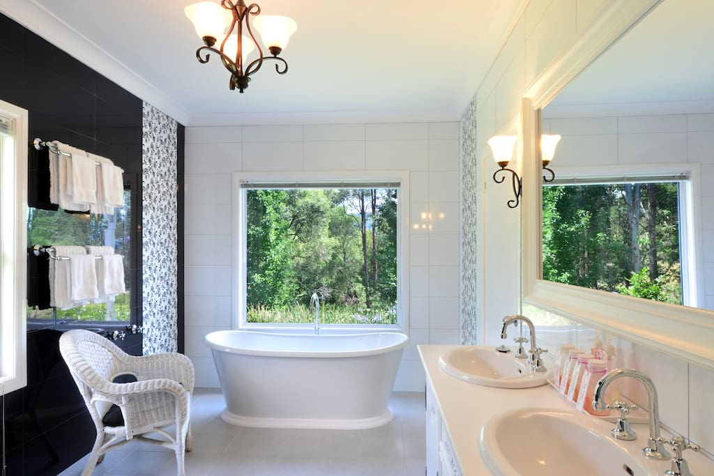 Stunning bathroom with free standing bath with views. Handmade bath salts galore!