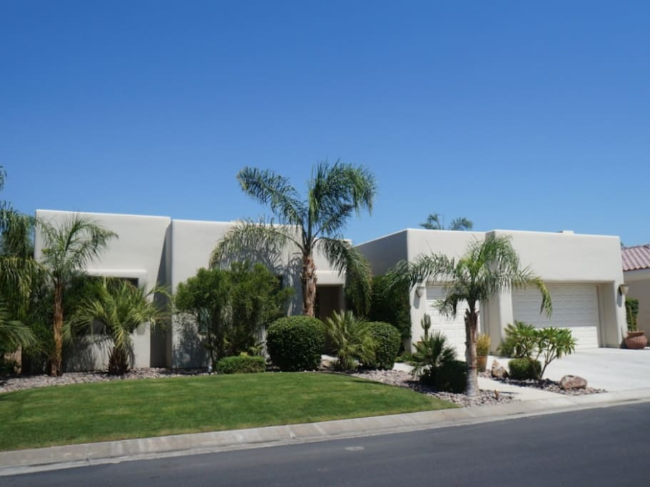 Wonderful Modern Desert Home with lush landscaping and 3 Car Garage in gated Community.
