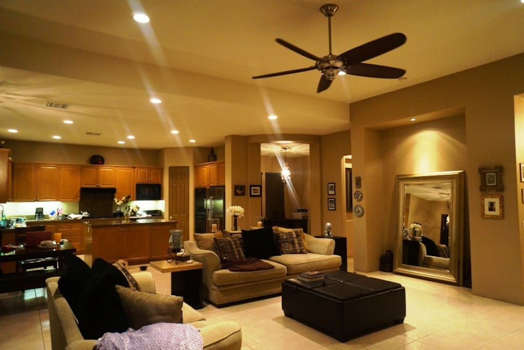 Living Room with roaring 12 feet ceilings, open Dinning , Kitchen and Office.
