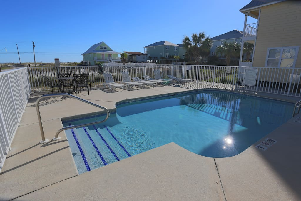 The quiet Three C's community includes an on-site pool