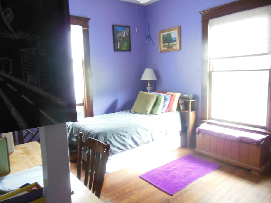 "This is the ""library"" or purple guest room. When two people want to share a room but not share a bed, this is where they sleep. We add another twin bed to the room."