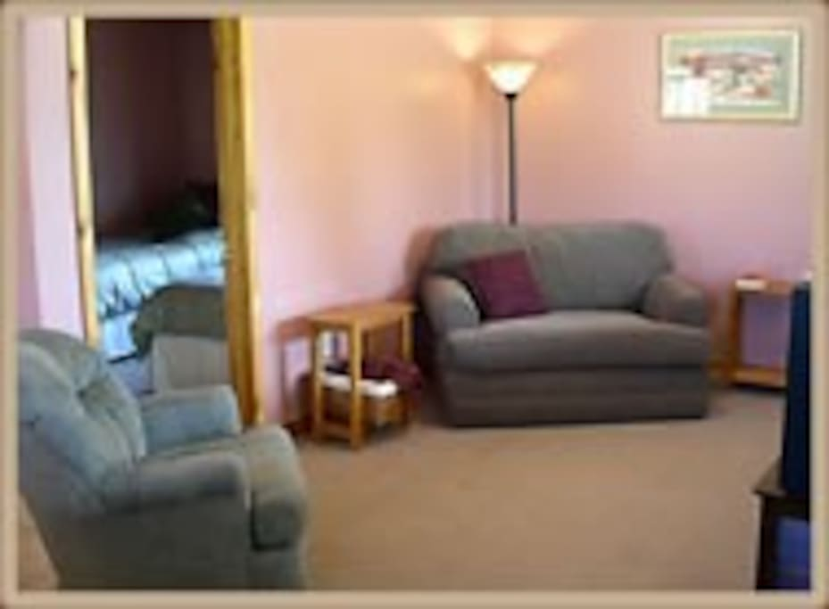 Living room, where you can visit, or curl up with satellite tv.