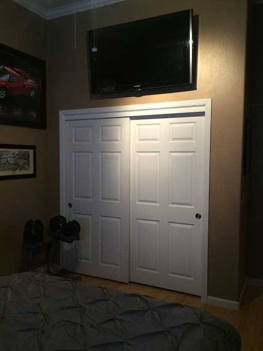 Closet access with hangers.  Wall mounted flat screen tv with dvd player and Direct TV access.