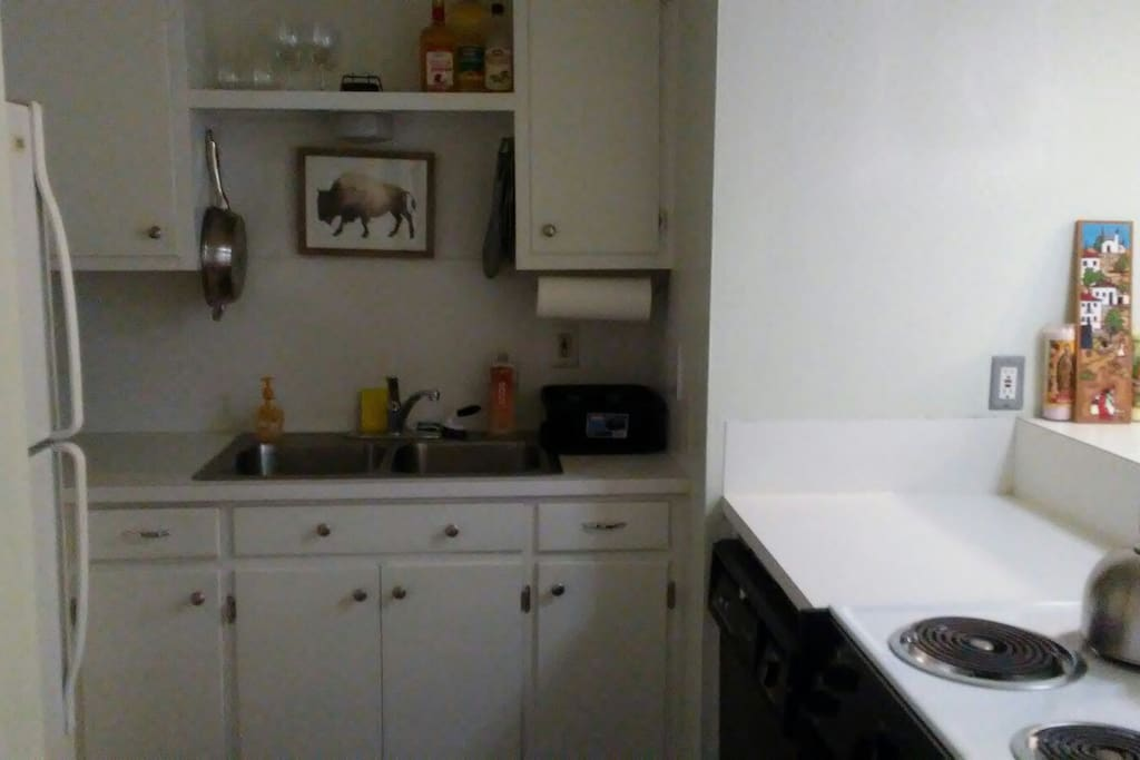 Open kitchen with electric stove & oven, dishwasher, & toaster oven plus all your cookware