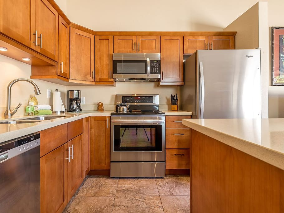 Well Equipped Kitchen With Stainless Steel Appliances