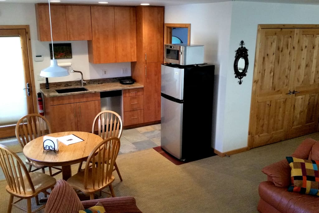 Dining table adjacent to kitchenette.
