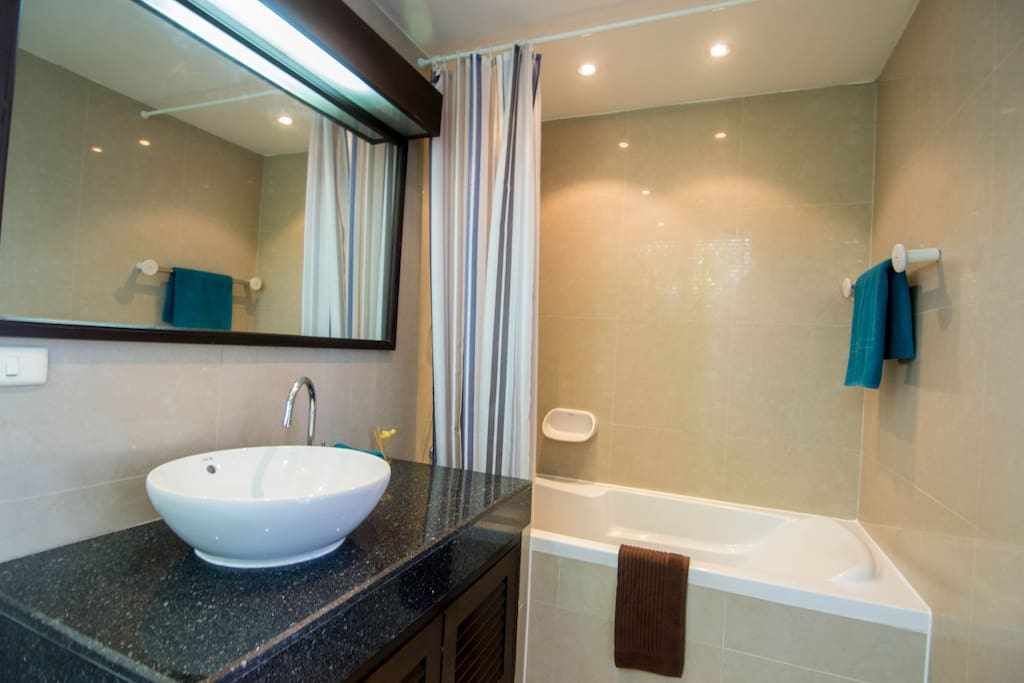 En-suite master bathroom with bath and shower