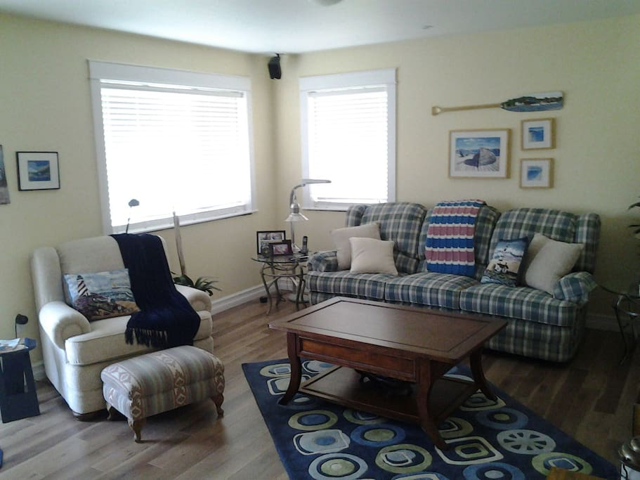 TV/reading/relaxing room with access outside to covered patio and hot tub.
