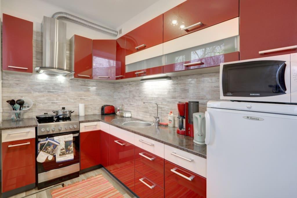 Kitchen with necessary appliances.