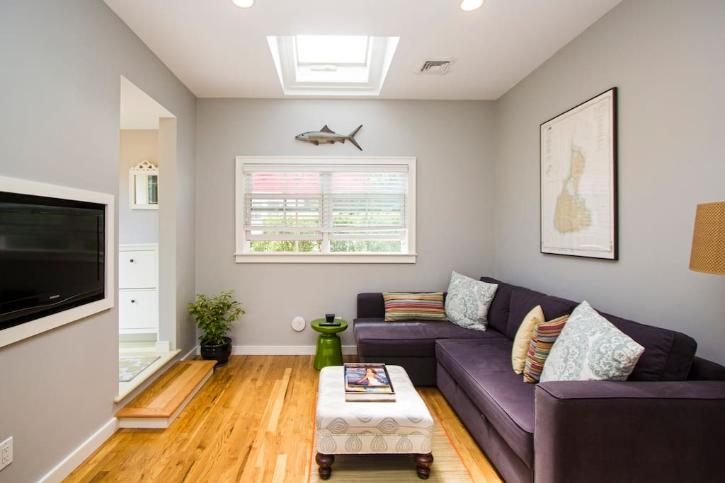 Skylights allow plenty of natural light, but feel free to draw the shades for privacy