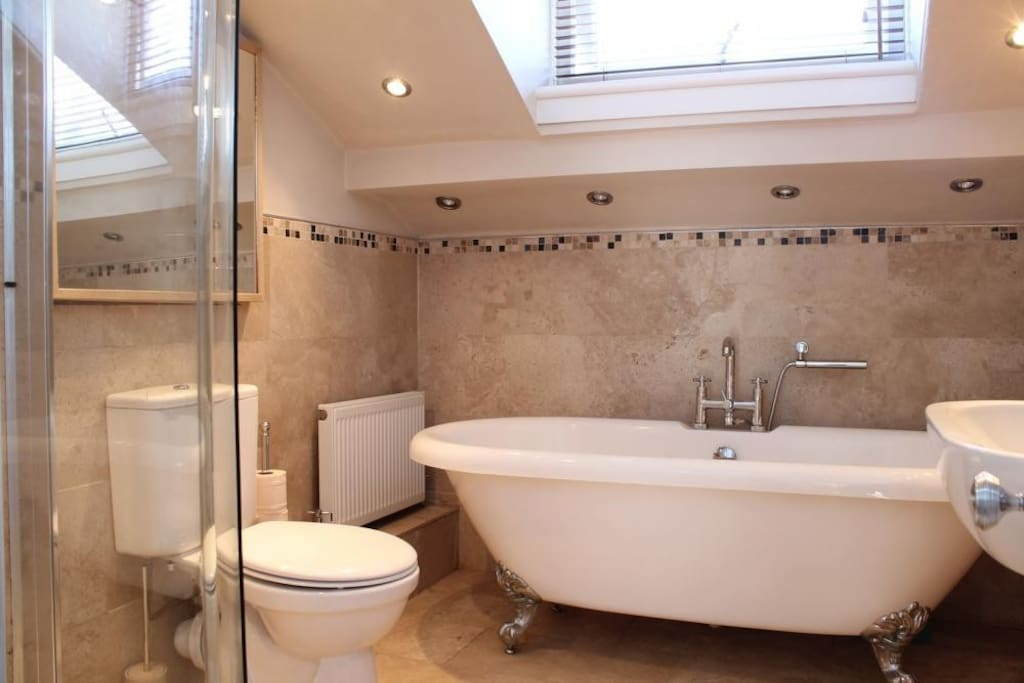 Modern bathroom with freestanding bath and separate shower