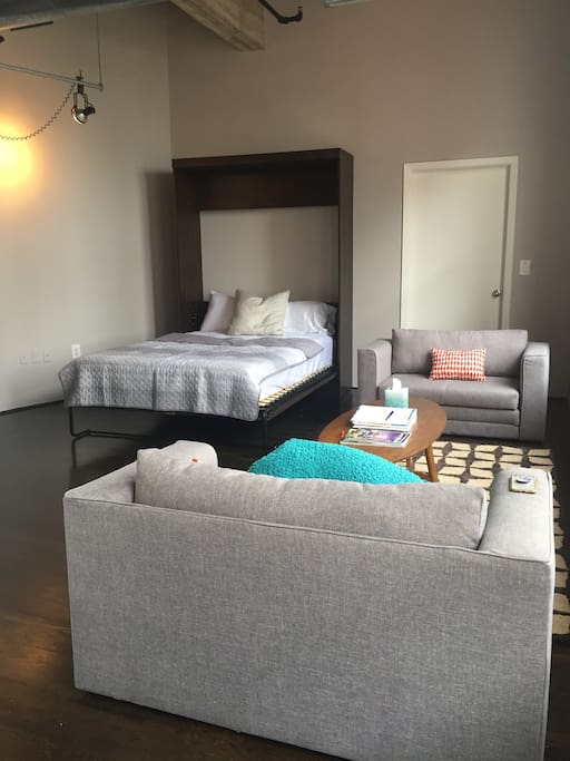 Queen size Murphy bed; futon chair and a half folds out to twin size bed