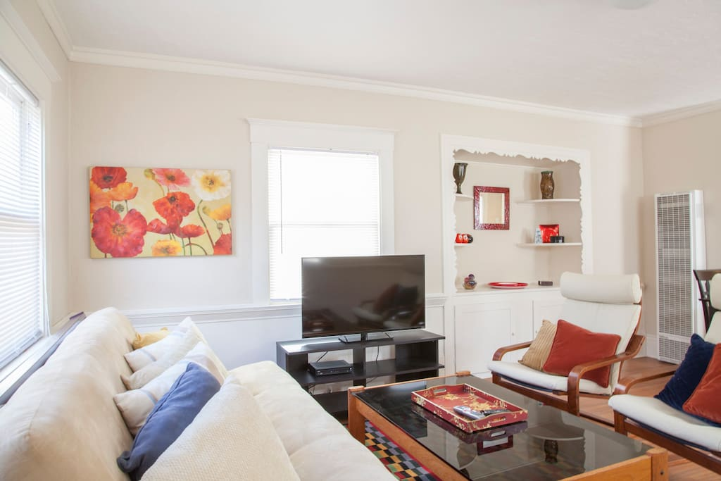 The living area features lots of sunlight, comfy furniture, double size futon/couch, a large 42 inch HDTV with cable and WiFi.