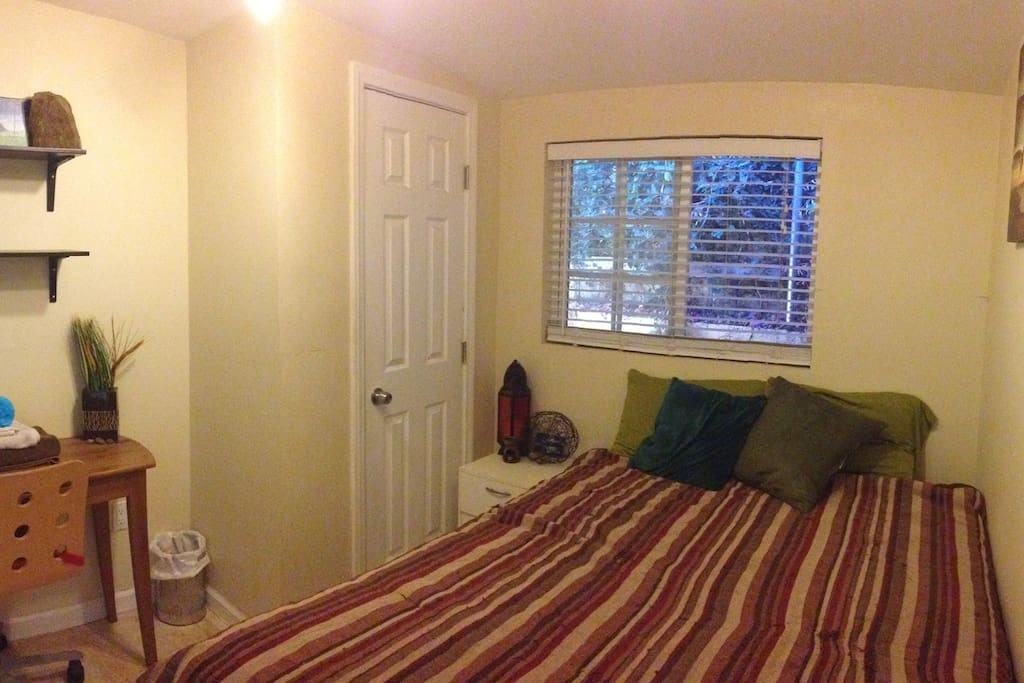 Bedroom you'll be staying in. Small closet, night stand and desk.