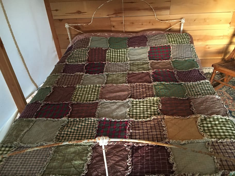 The comfy full-size bed and homemade quilt