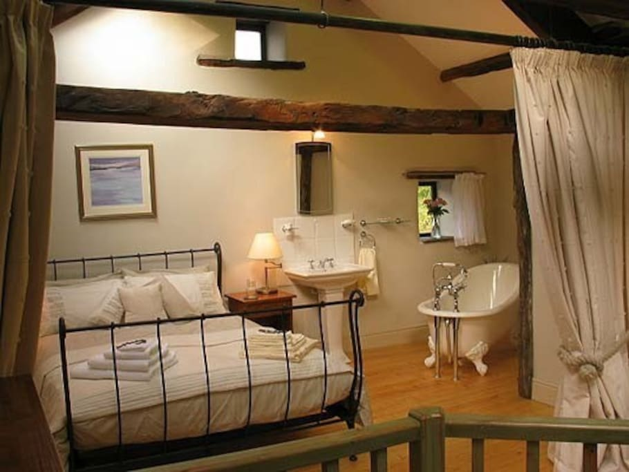 Romantic bedroom complete with slipper bath, on the Mill's upper level.