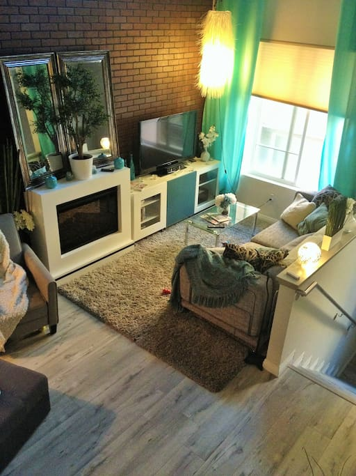 Living space, sleeper couch, fireplace