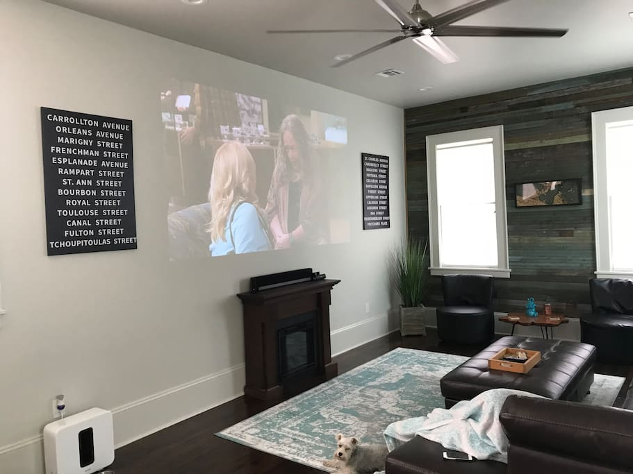 Comfortable living room with projector