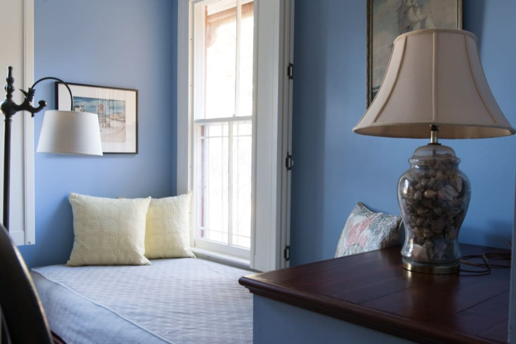 Twin-sized mattress on a cozy built-in daybed provides room for a second or third guest (though three adults is quite tight in this space!) or a perfect place to read and nap