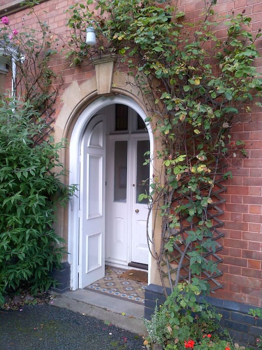 Period arched entrance porch with key safe.