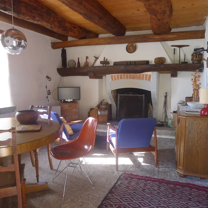 On the first floor, a small lounge/dining room with a large fireplace