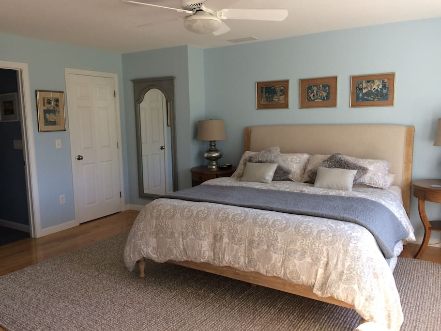 The master bedroom is decorated with vintage Japanese woodblock prints and other original art.
