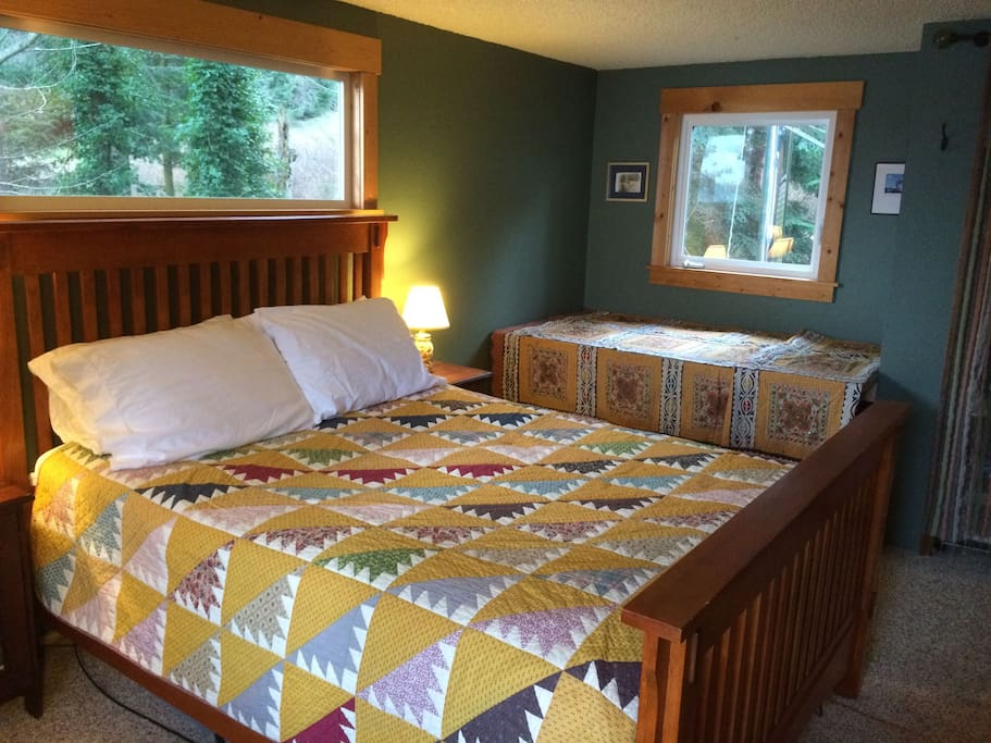 Master bedroom includes a queen bed and an elevated day bed -- perfect for reading a book or staring at the sky!