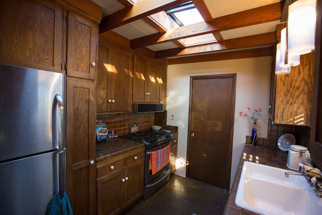 Fully stocked kitchen with skylights and gourmet stove.