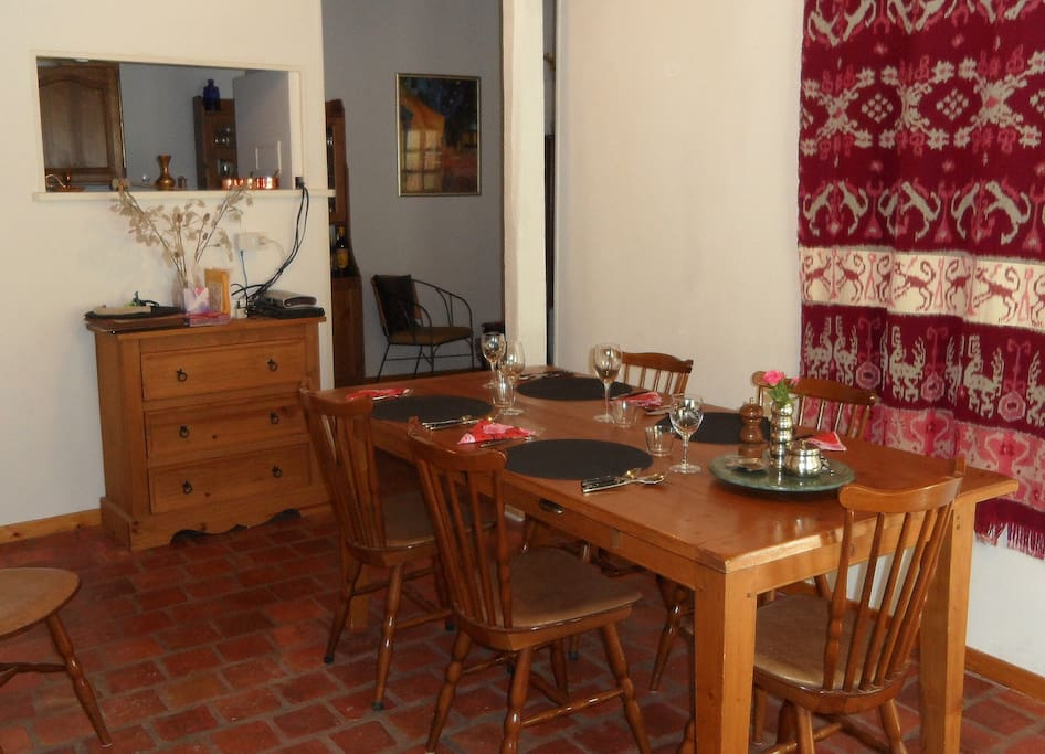 Dining area near kitchen and opening on to the court yard