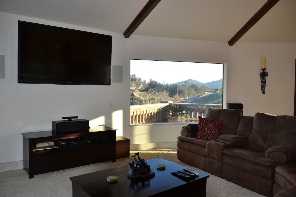 70 inch flat screen surrounded by picture windows and stunning views