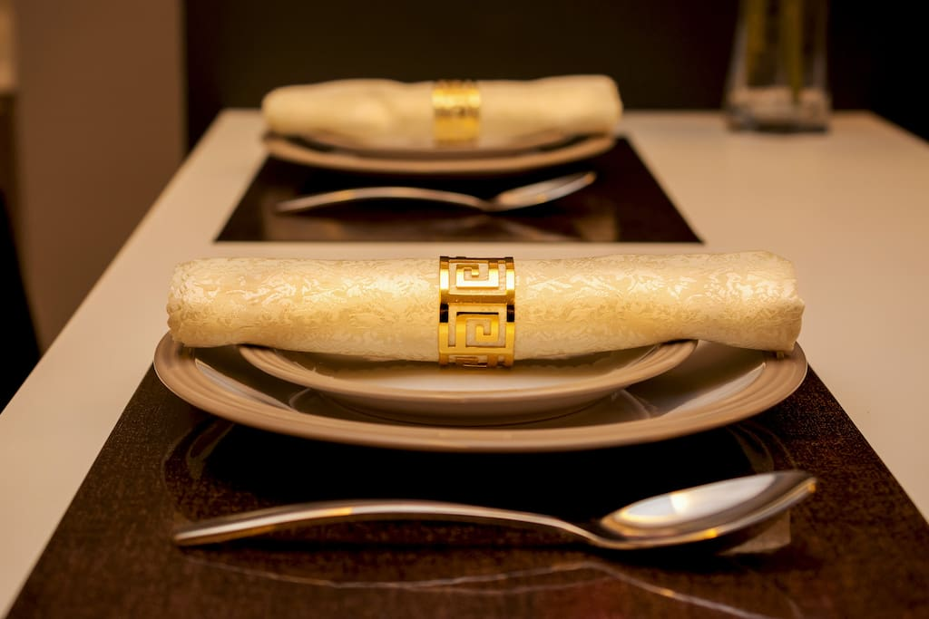 Plates, cutlery, napkin, table mats are provided