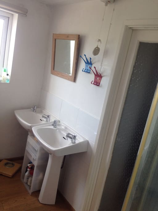 The sink by the window is for the Little Room, the one by the door for the Big Room.