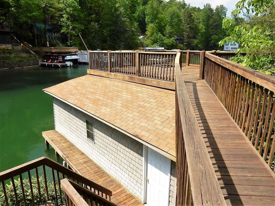 The home has a spacious boat house complete with dock and topside deck.