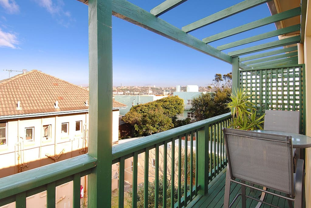 L-shaped deck with views to Bondi Beach, BBQ and outdoor setting